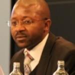 [Image: Dr. Moses Muwonge]